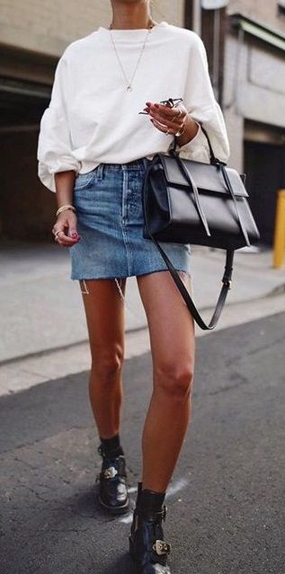 sweatshirt. denim skirt. buckle boots. street style.