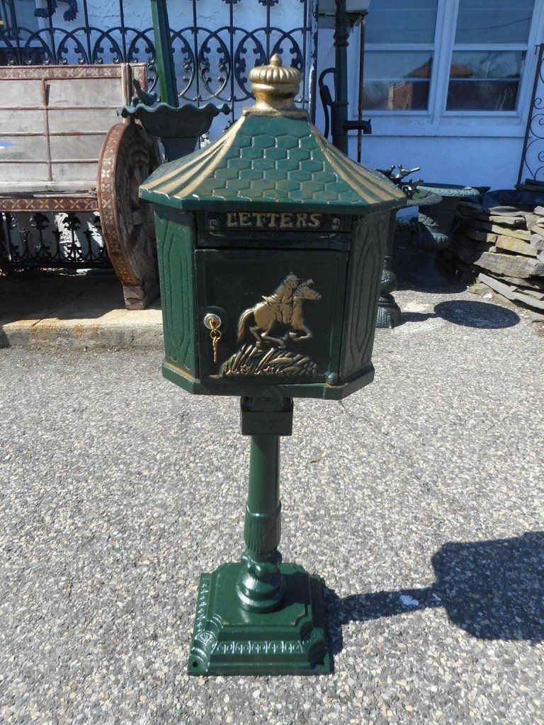 An Amazing Cast Iron Mailbox With A Decorative Front And A Locking Door Beautiful Piece With A Man Riding A Antique Mailbox Vintage Mailbox Antique Cast Iron