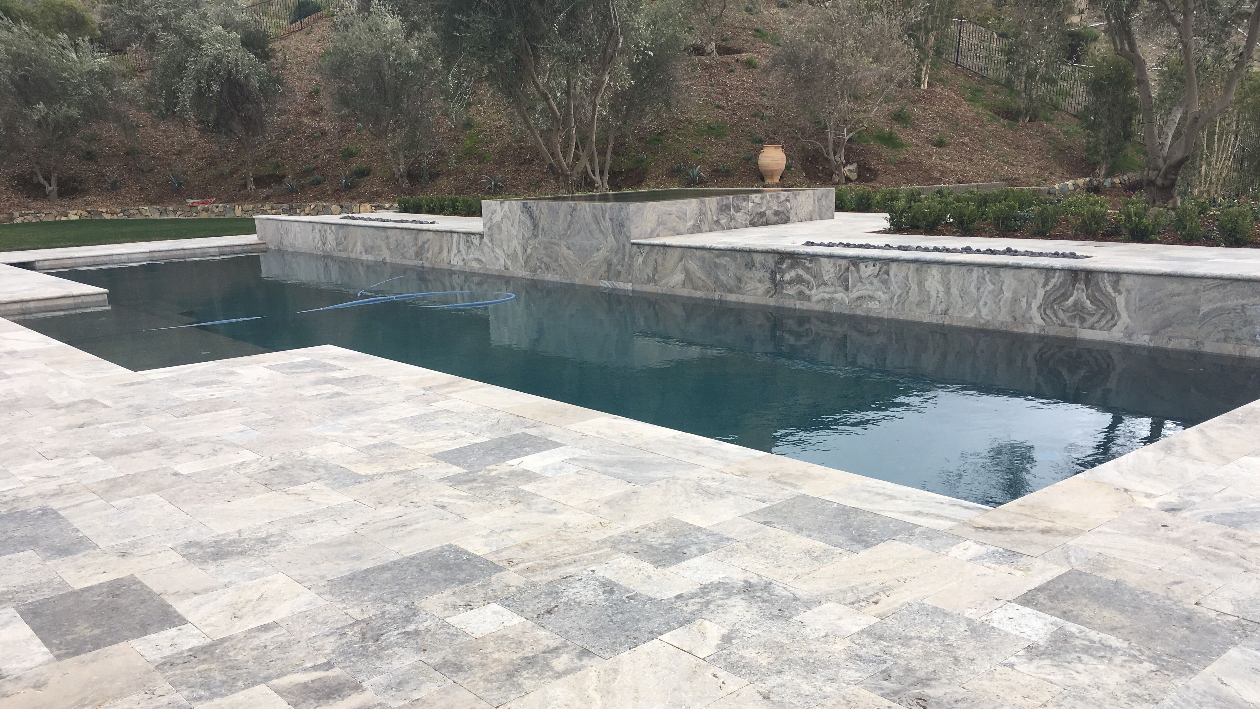 Exterior Design With Versailles Pattern Pavers And Pool Coping