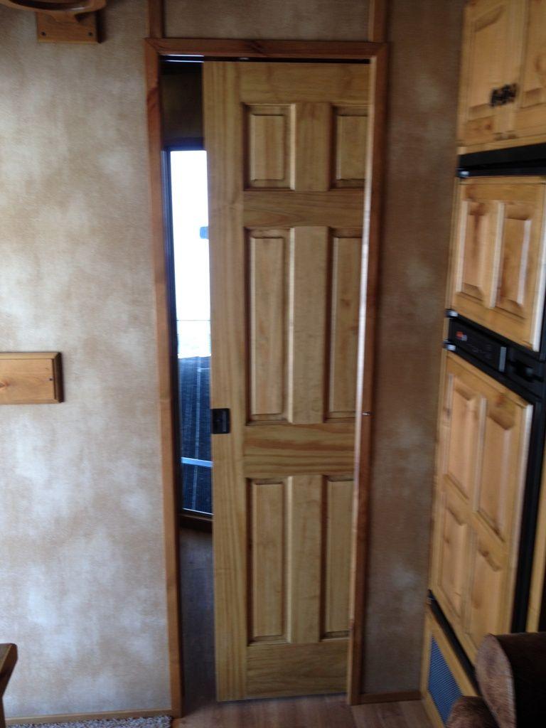pocket door to bathroom | tall cabinet storage, bathroom