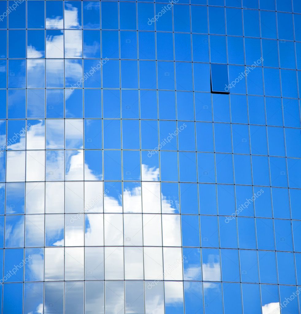 Highrise Glass Building With Sky And Clouds Reflection Royalty