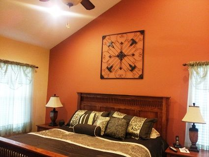 Burnt orange accent wall looks nice against yellow as for Burnt orange bedroom ideas