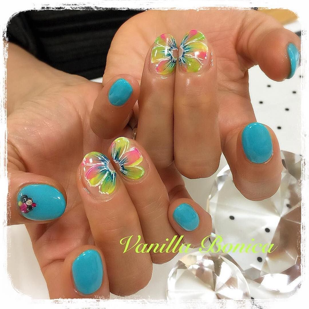 Yellow blue and pink work well together especially in flowers! Design by @vanilla_bonica! #nailart | Featured by @MendaBeauty