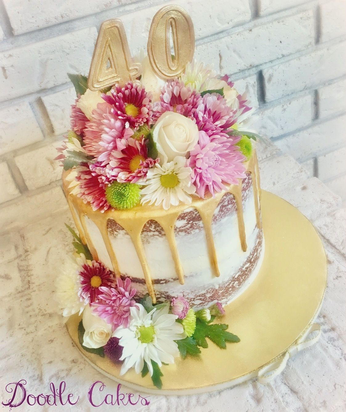 Elegant 40th Birthday Cake With Fresh Flowers And Gold Drip