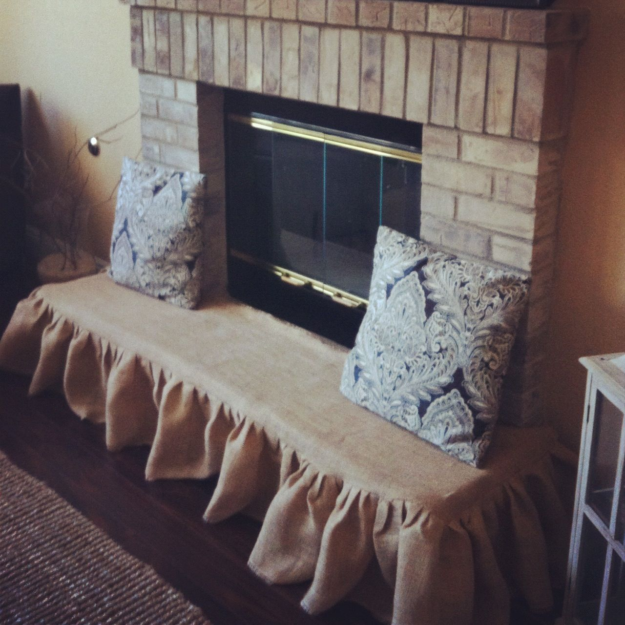 Baby proofing brick fireplace. Not exactly how I would do it, but a great idea to get started ...