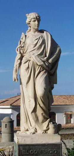 """""""El Comercio""""  El Comercio está representado por una figura femenina de 115 centímetros de altura, con sombrero alado que porta en su mano derecha un caduceo."""