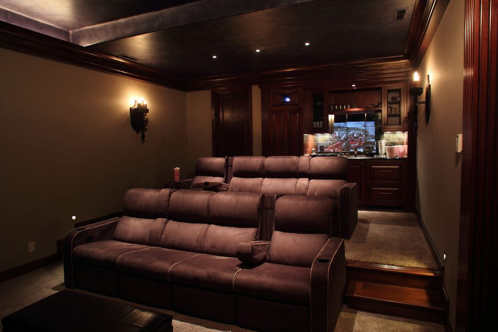 Home Theater Room Design Ideas brown and beige color scheme home theater room with individual leather chairs in stadium seating format 1000 Images About Theater Room On Pinterest Home Theater Rooms Home Theaters And Media Rooms