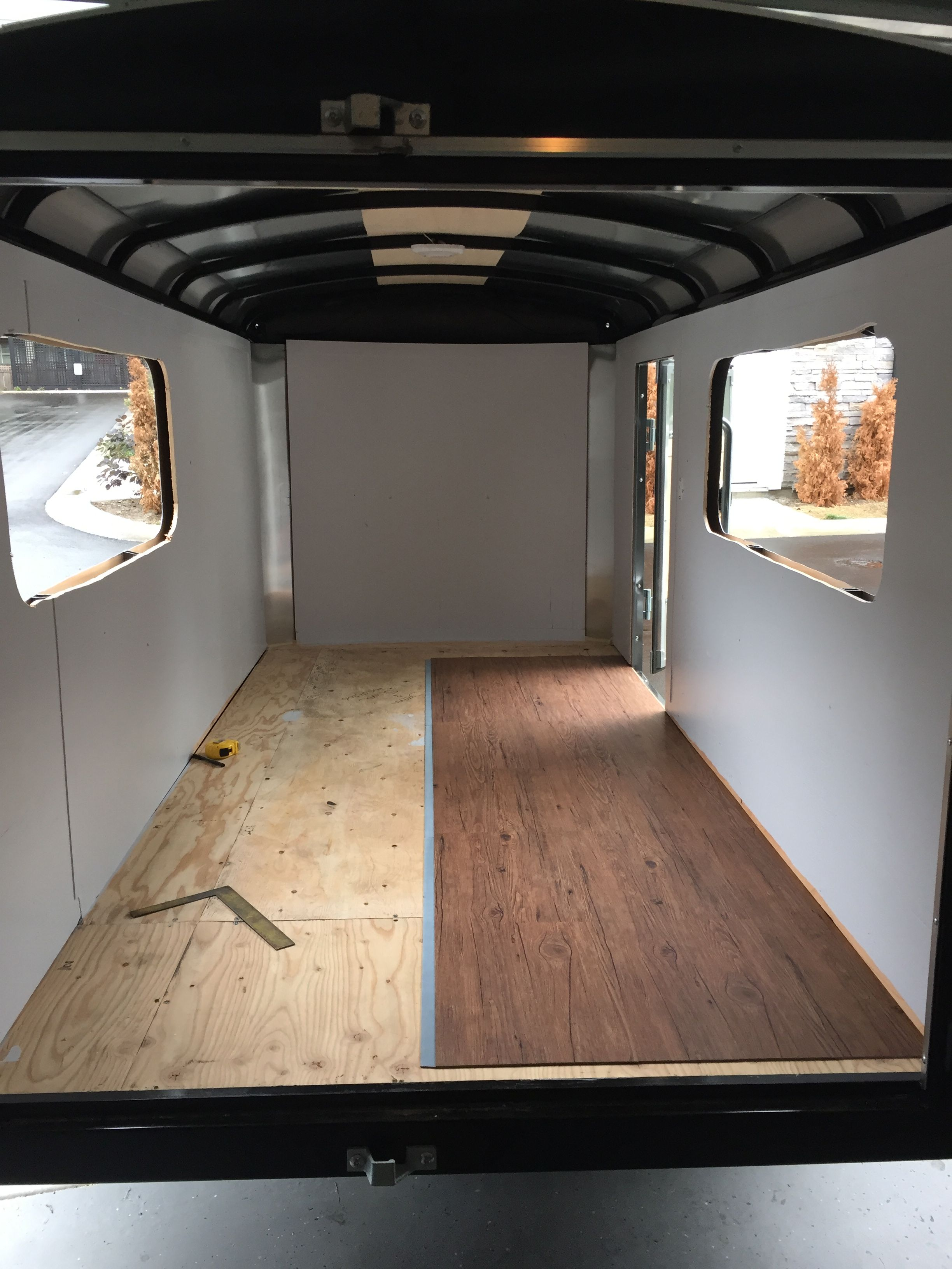Cut out windows painted walls with exterior paint and Painting interior travel trailer walls