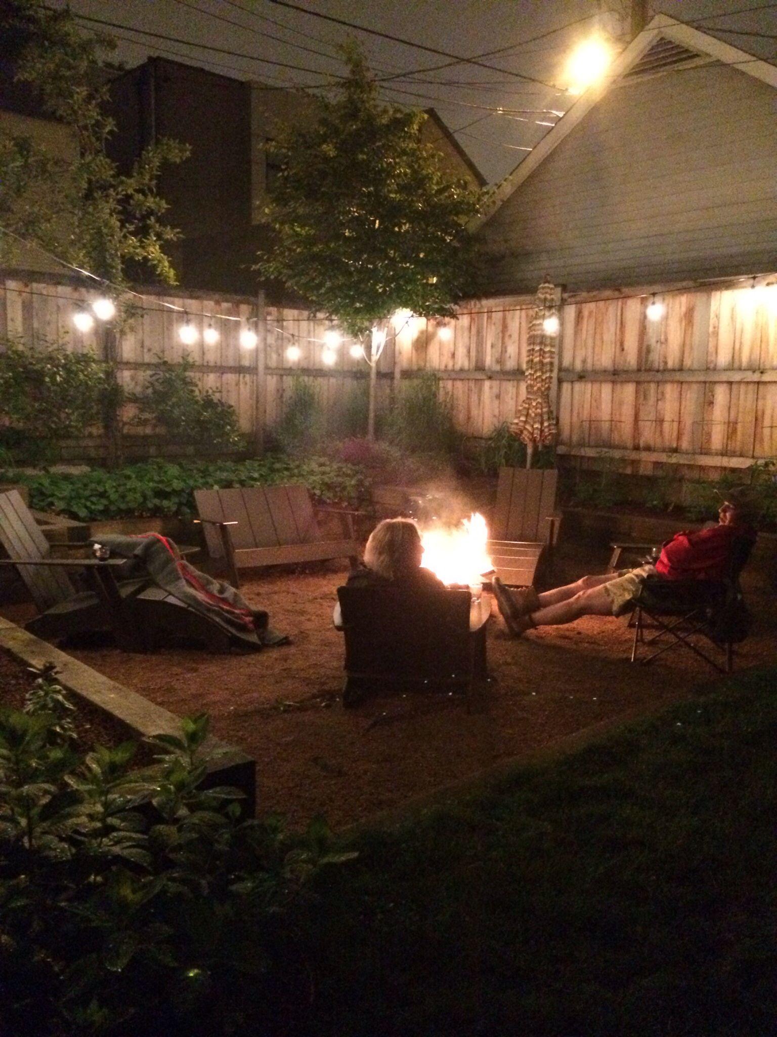 chilly summer night in chicago garden lights loll furniture