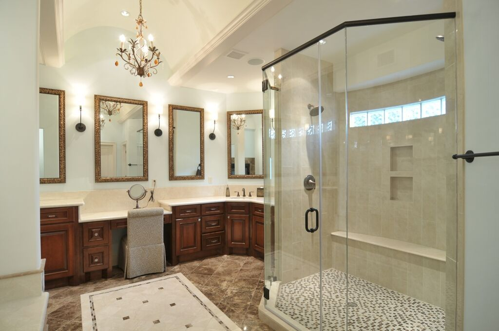 Dark cabinets can add drama to a bathroom when paired with white counter-tops and white walls.