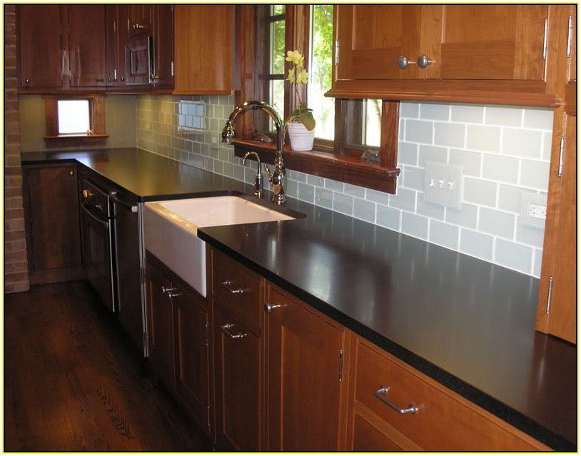 Charming Subway Tile Backsplash With Dark Cabinets