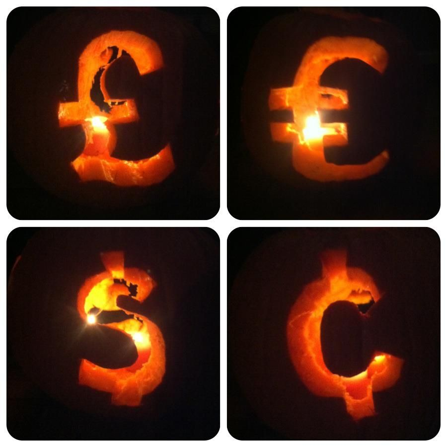 Money makes the world go round our pumpkin symbolizes the our pumpkin symbolizes the different currencies around the world it has 4 different symbols on each side of the pumpkin biocorpaavc