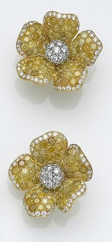 A Pair Of Yellow Diamond White And Eigh Karat Gold Earrings