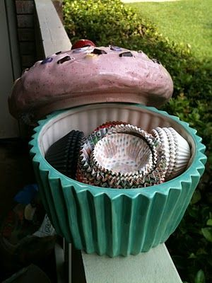 Giant painted ceramic cupcake filled with cupcake liners! Need to get one of these :)
