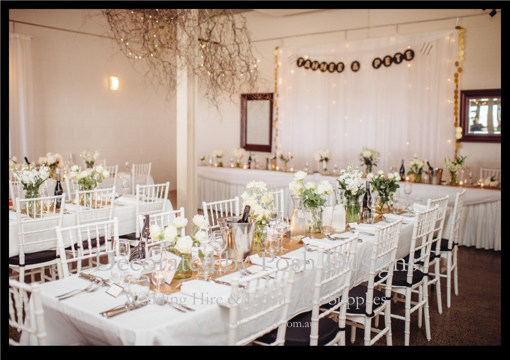 White tiffany chairs white table cloths gold table runners