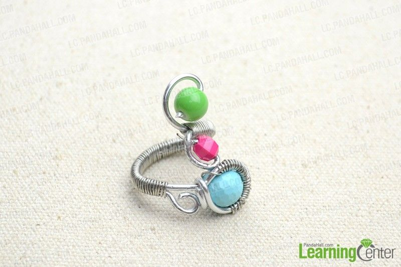This tutorial will provide you a simple way to create your own ring with silvery copper wire and colorful glass beads. After the tutorial, you will find the pleasure of creating wire wrapped jewelry.