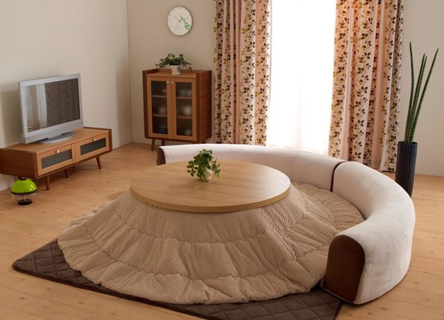 cute round kotatsu ...its a small japanese heated table with a blanket for winter