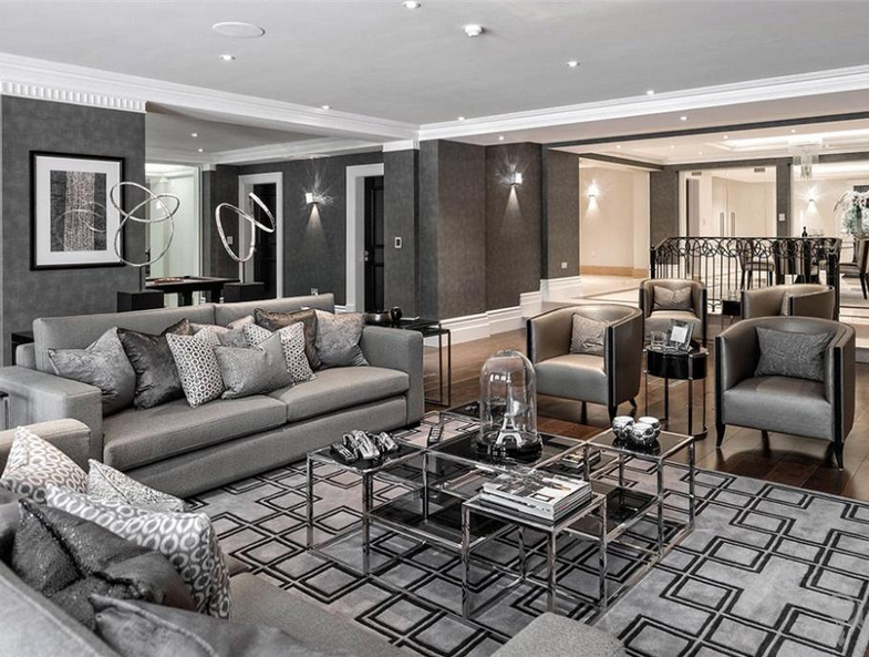 Grey Living Area with Eicholtz rug and coffee table. Scatter cushion arrangement.