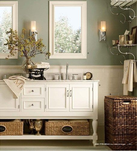 Gratifying Green By Sherwin Williams Light Sage Green Bathroom Color With White And Wicker Accents J Green Bathroom Pottery Barn Bathroom Green Bathroom Colors