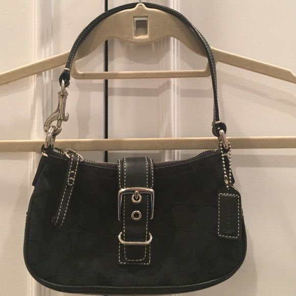 Coach Handbag Small black Coach handbag. Strap and buckle look on front with snap closure. Black leather handle. Small compartment inside bag. Like in new condition. Any reasonable price will be accepted! Coach Bags