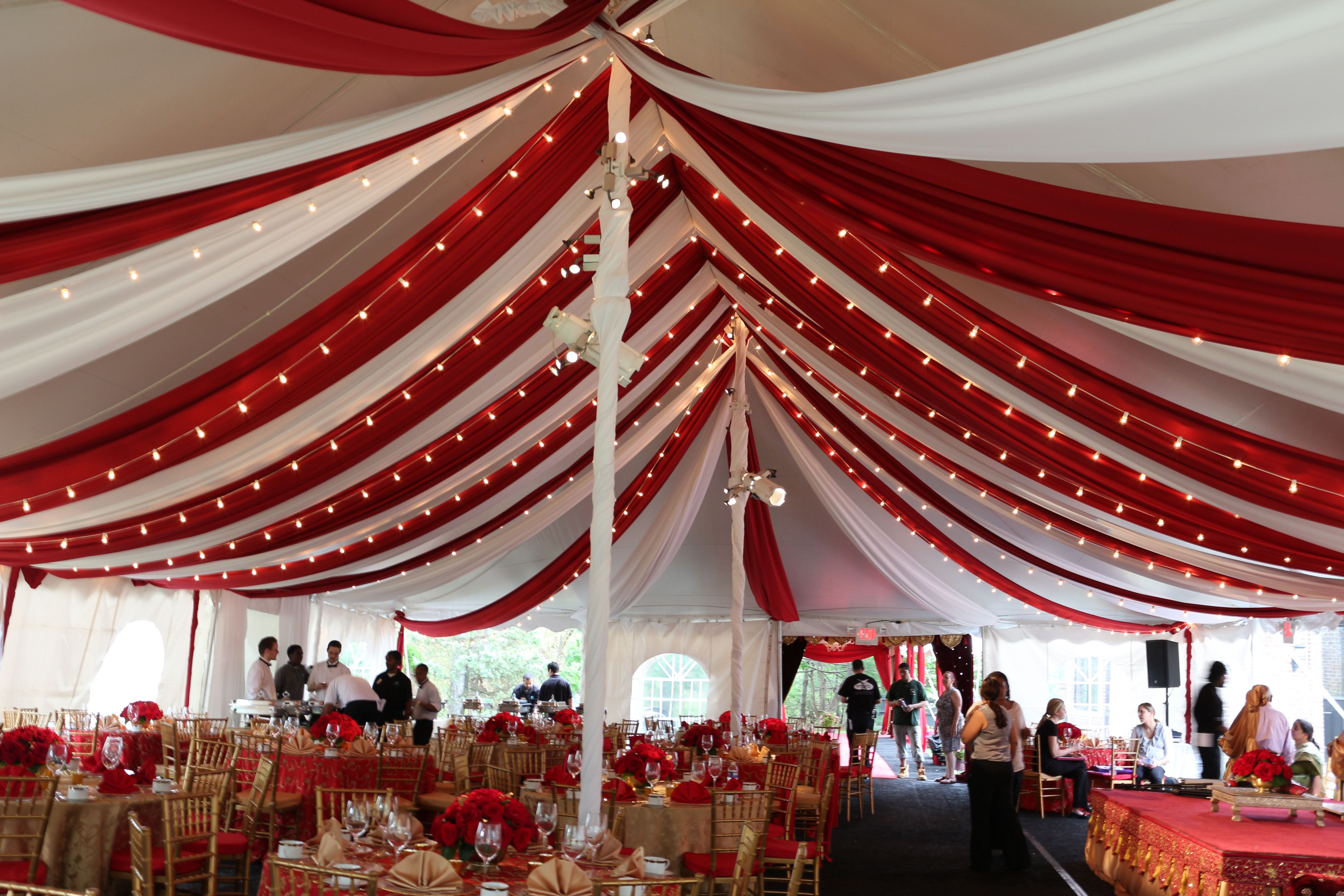 Red and white drape tent liner, uplighting, string