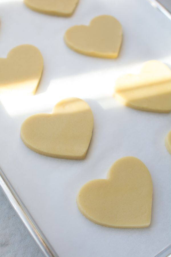 Rich and buttery Cut-Out Sugar Cookies are the most tender melt-in-your-mouth sugar cookie. This no-chill dough rolls out beautifully and the cookies hold their shape perfectly when baked. #sugarcookies #cookies #cutoutsugarcookies