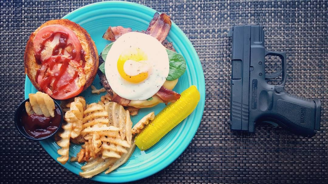 Link in bio#thatchillaxdude   Bacon egg burger on a brioche bun and guns... America!  #followyourarrow #travel  #wandern #travelbug #travelgram #wanderlust #notallwhowanderarelost #instalike #instatravel #instatraveling #photography #holiday #followme #travelblogger #passportready #worldtravel #love #foodpairing #beer #burger #brioche #bacon #egg #springfieldarmory #fiestaware