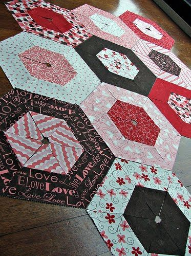 Jaybird Quilts... another triangle-hexagon with string piecing. Loving this!