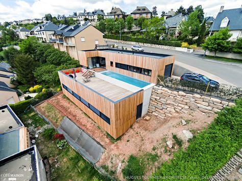Maison bois avec terrasse et bassin de nage en béton banché, Rodez - terrasse bois avec bassin