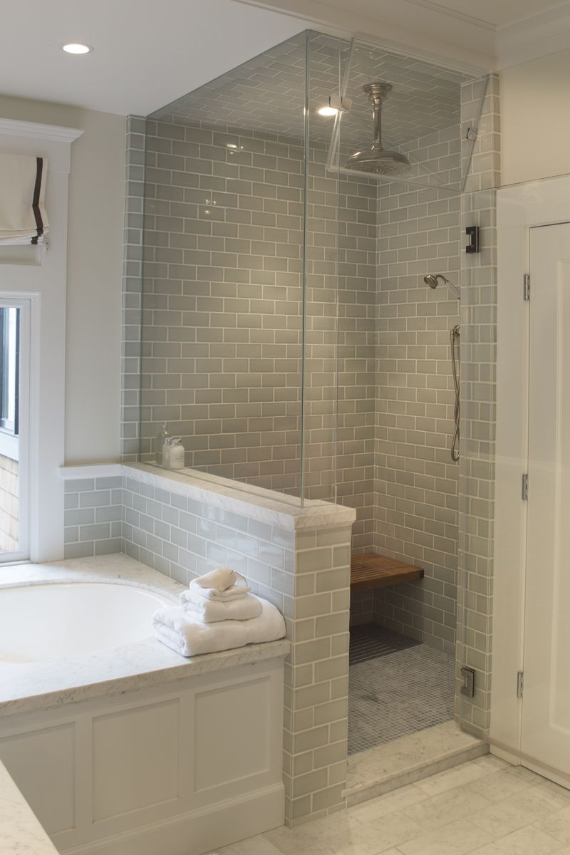 Master Bathroom Knee Wall glass-enclosed steam shower and soaking tub in master bath. built