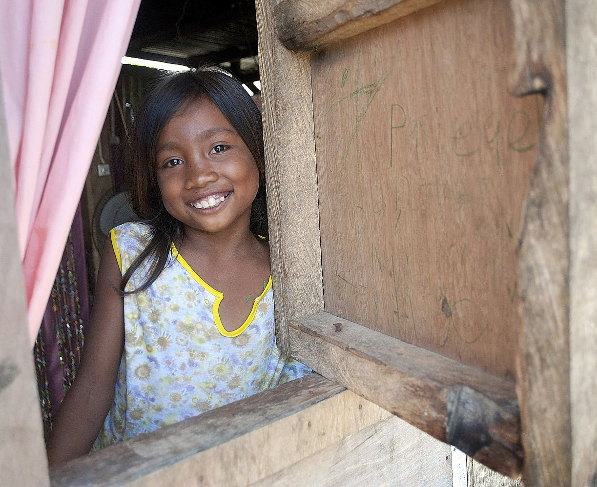Edilen's smile shows the peace that a stable home brings. Not so long ago, Edilen and her family lived through the terrifying winds and aftermath of Typhoon Haiyan. The family very nearly lost hope when they saw the destruction all around, but a shelter kit distributed by Habitat Philippines helped them rebuild — and smile once again.