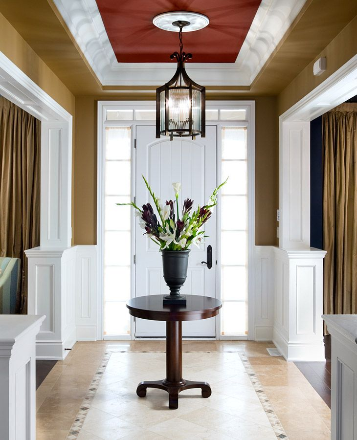 Foyer Designs: Bright Entrance Way With Tile Floor And Flowers On A
