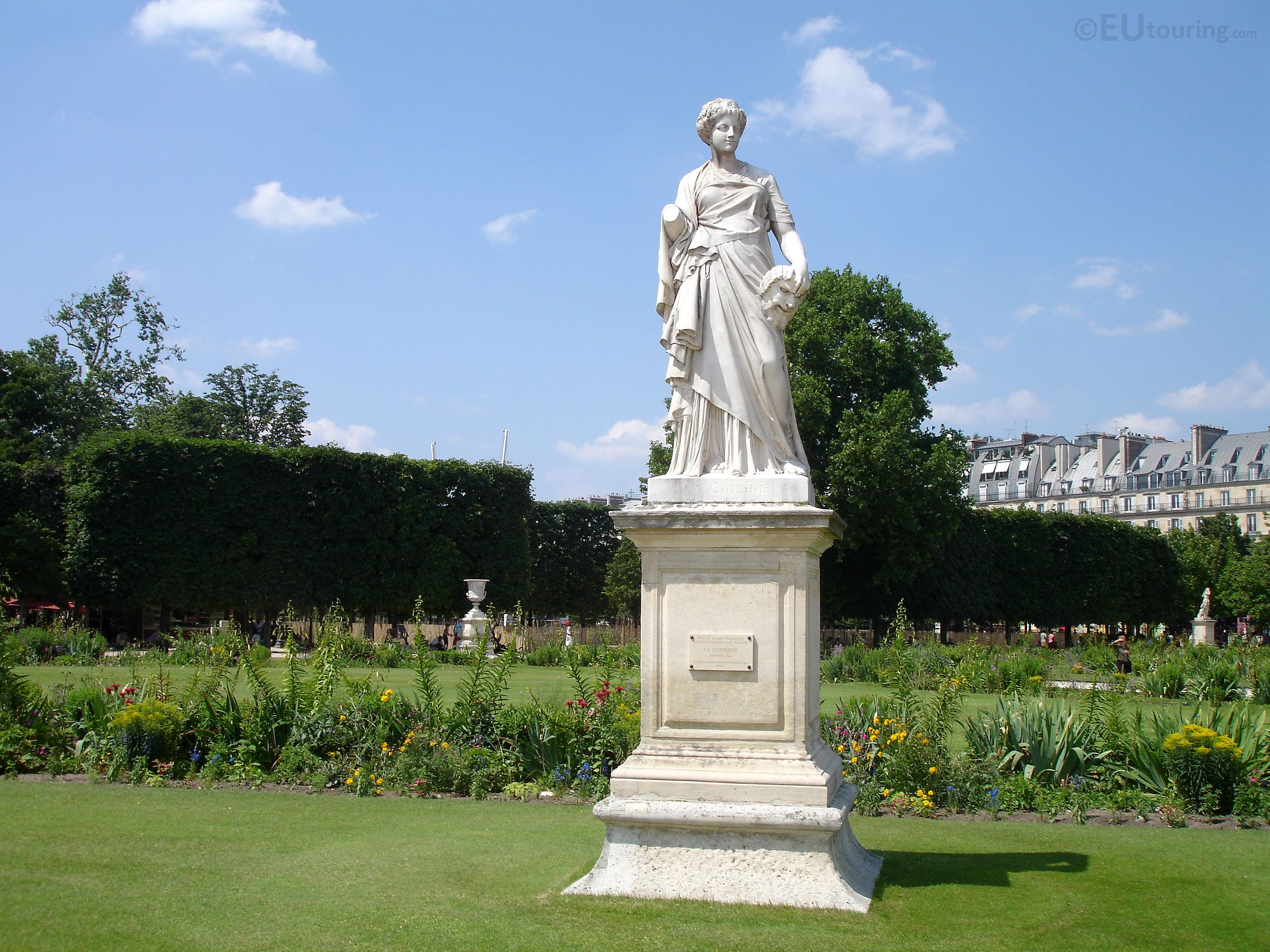 This statue called La Comedie can be found within the Tuileries Gardens and was sculpted by Julien Toussaint Roux in 1874 and has been in the gardens since.  You may also like www.eutouring.com/images_paris_statues.html