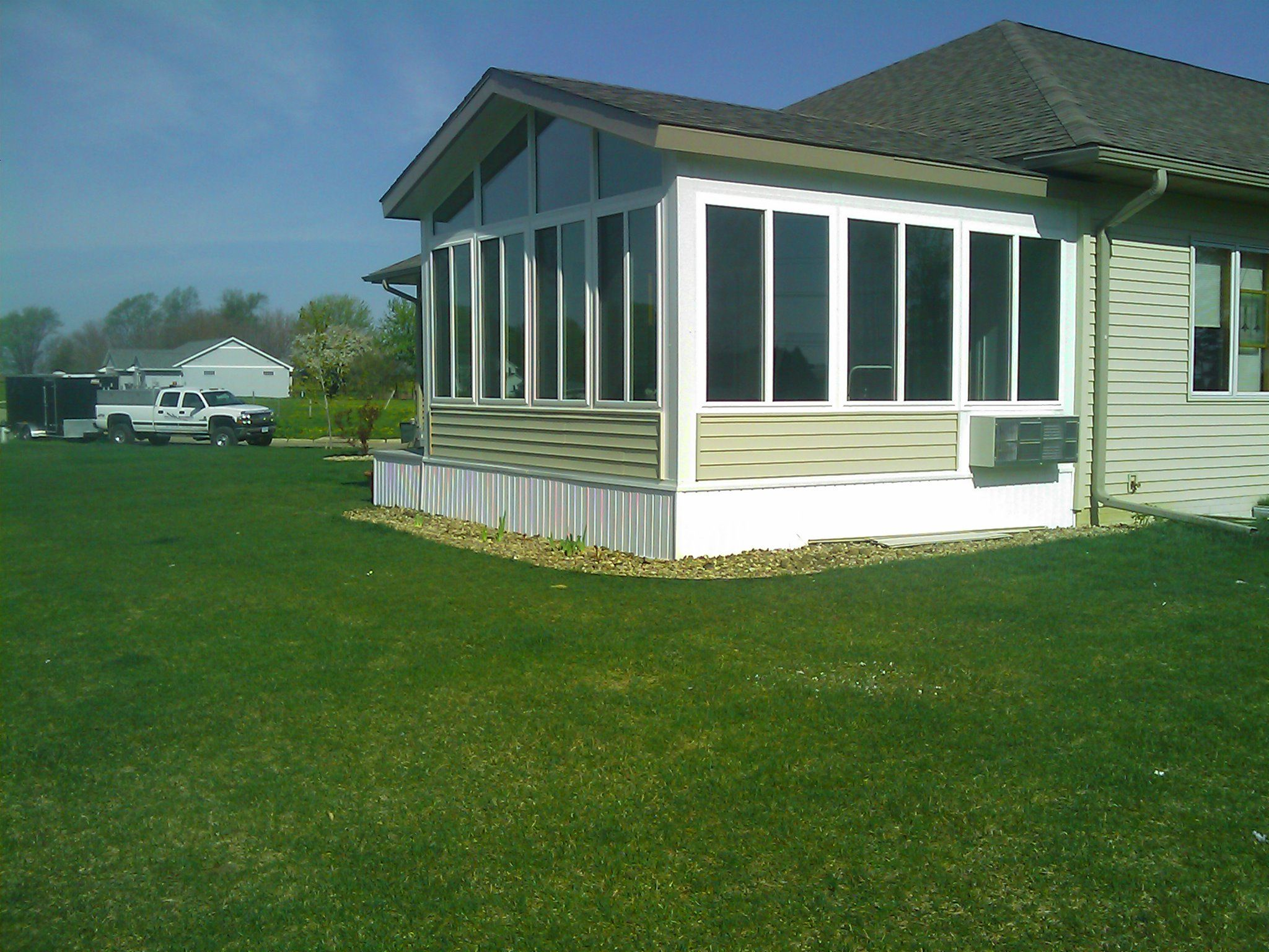 This sun room addition in cedar falls iowa keeps your feet for Solarium additions