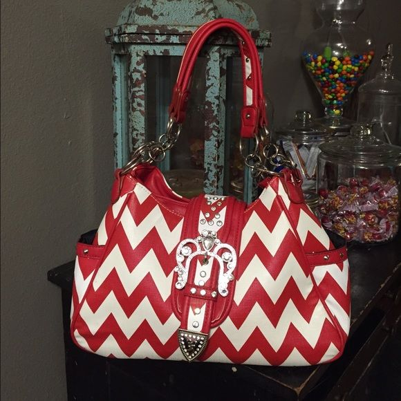 Red & White chevron purse ❤️Red & White chevron print purse with crystal & silver detail. ❤️2 side pockets, 2 big spaces inside purse, 1 side has a zippered pocket & other side has 2 small pockets got cellphone or lipgloss. Carried 1 time. Perfect condition! Bags