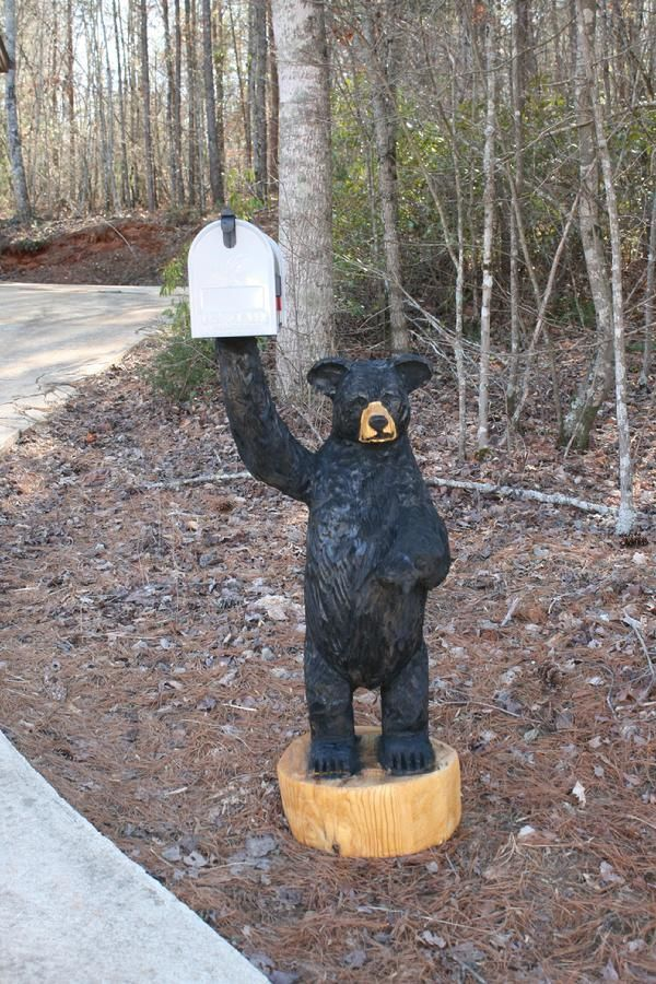 chainsaw carved bear holding
