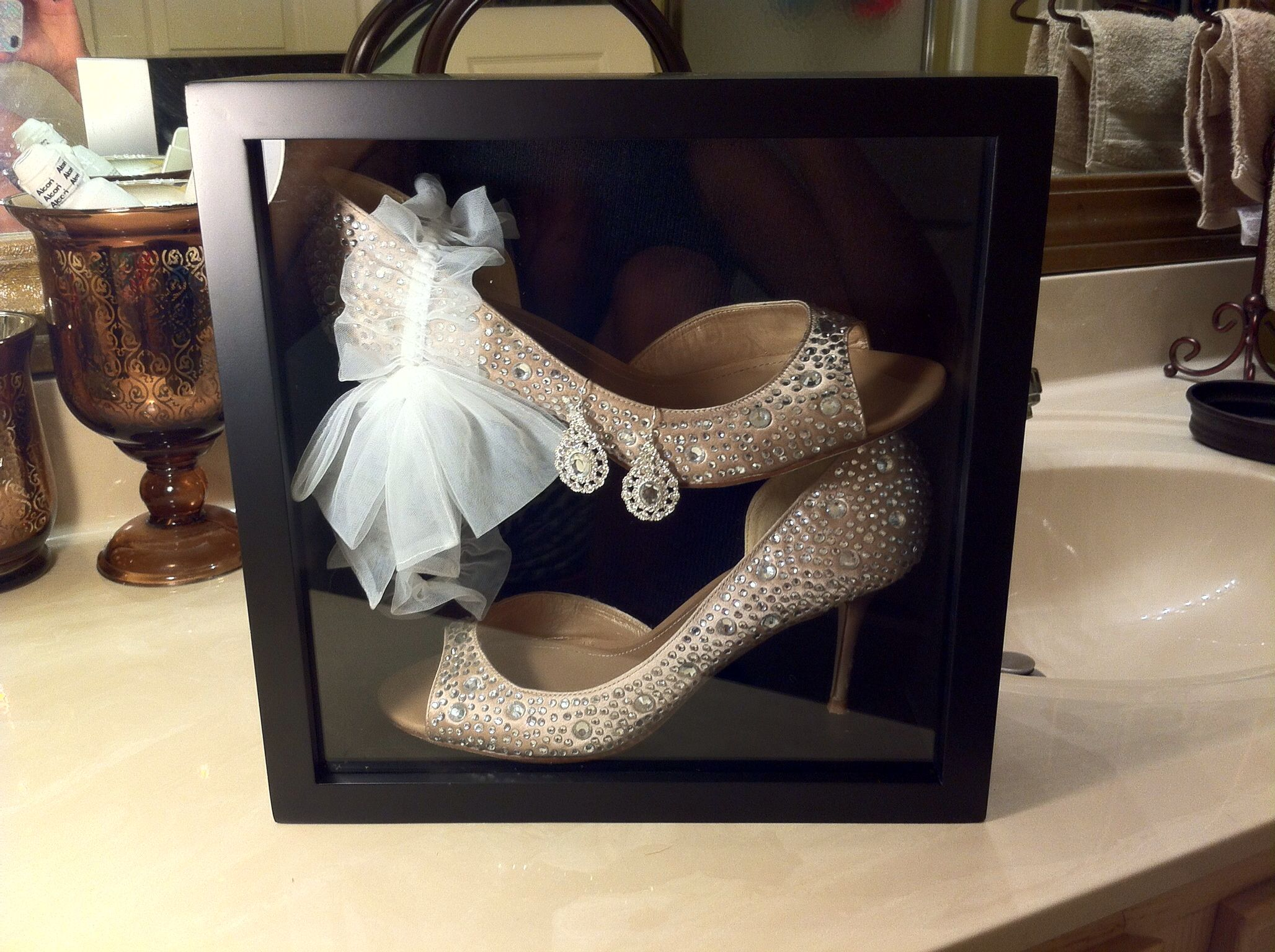 What a great idea placing your wedding shoes in a shadow box ...