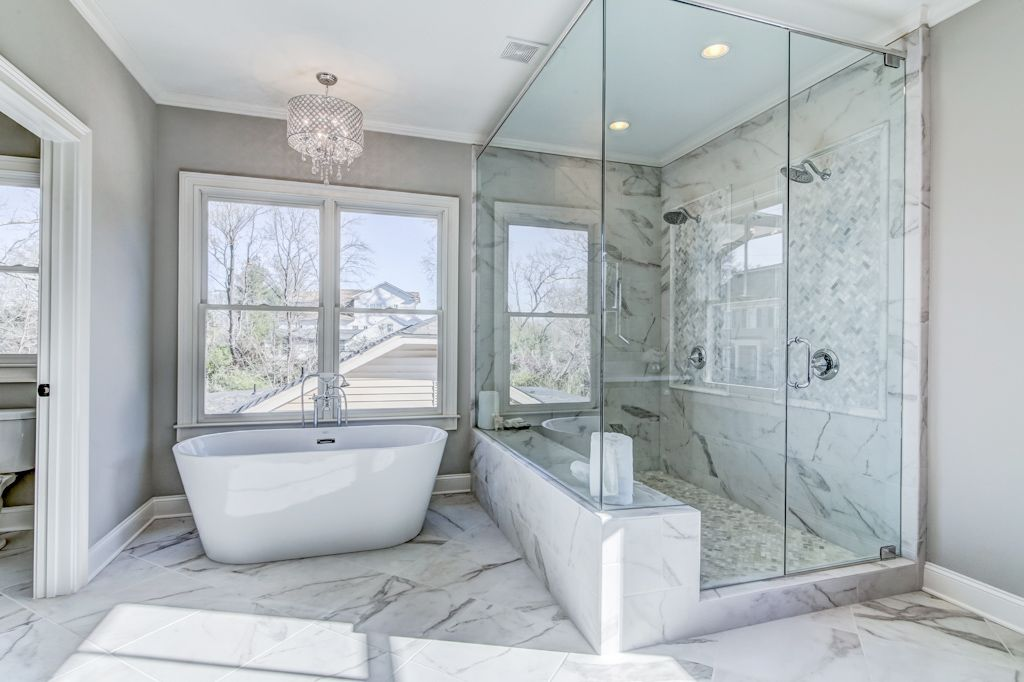 Master bath with marble look alike porcelain floors. Large double ...