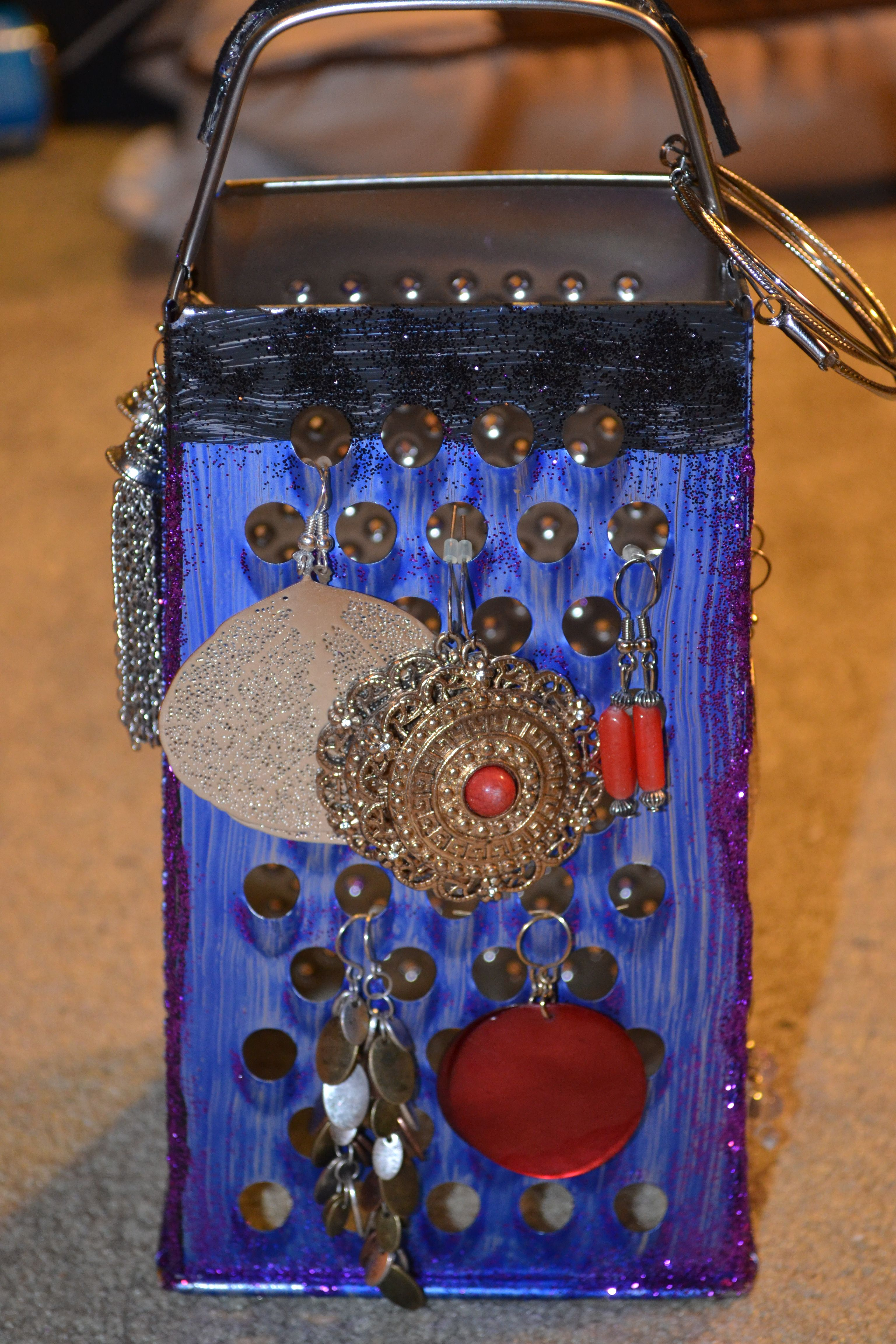 earing holder made out of a cheese grater