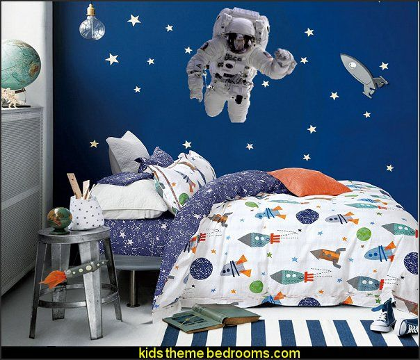 being a space traveller in the space themed bedroom bedroom wall