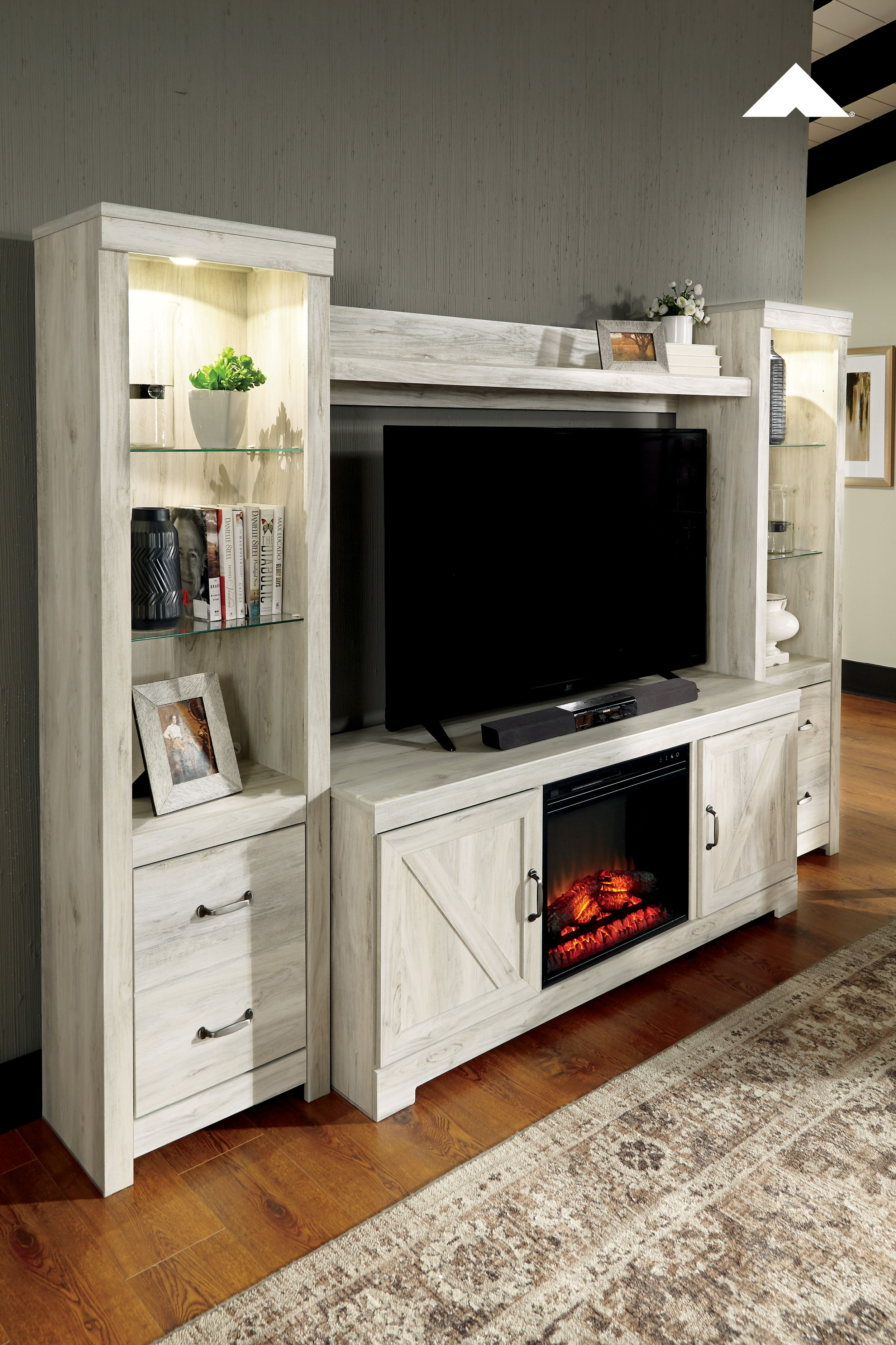 Meubles Ashley Floride Warm Up This Winter With Our Bellaby Large Tv Stand W Fireplace