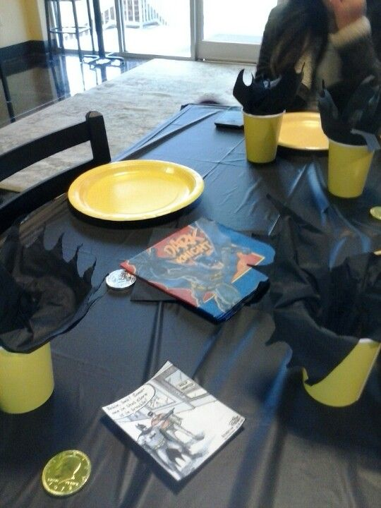 Batman table set up with comic strips