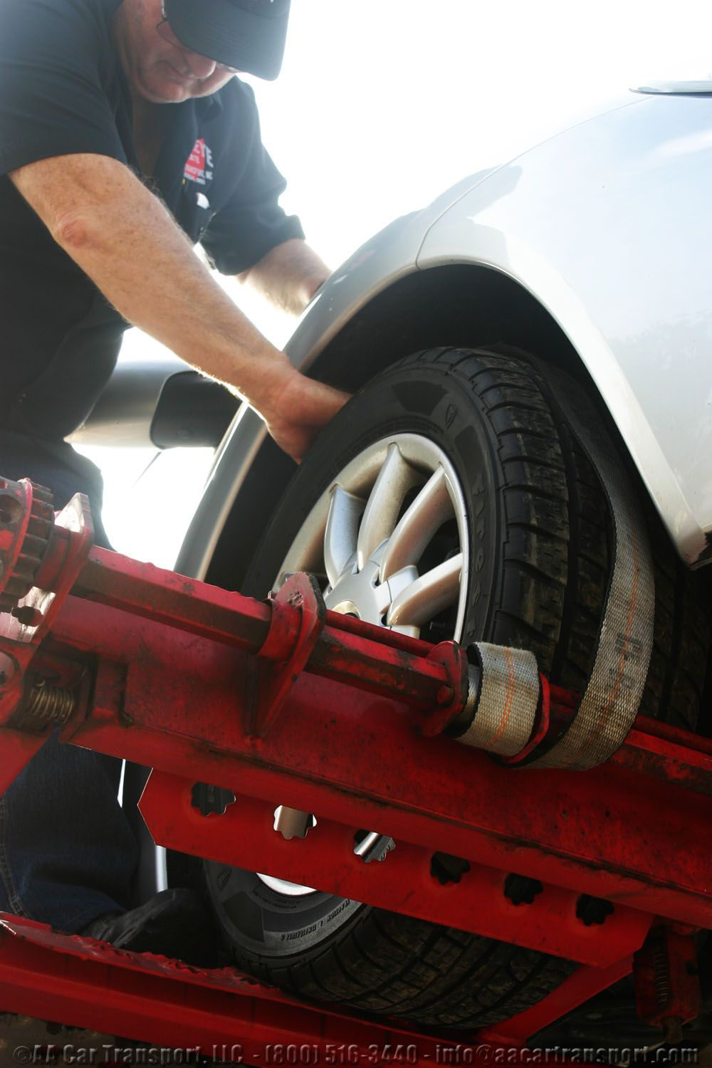 How to ship a car Place tire straps on wheels to secure