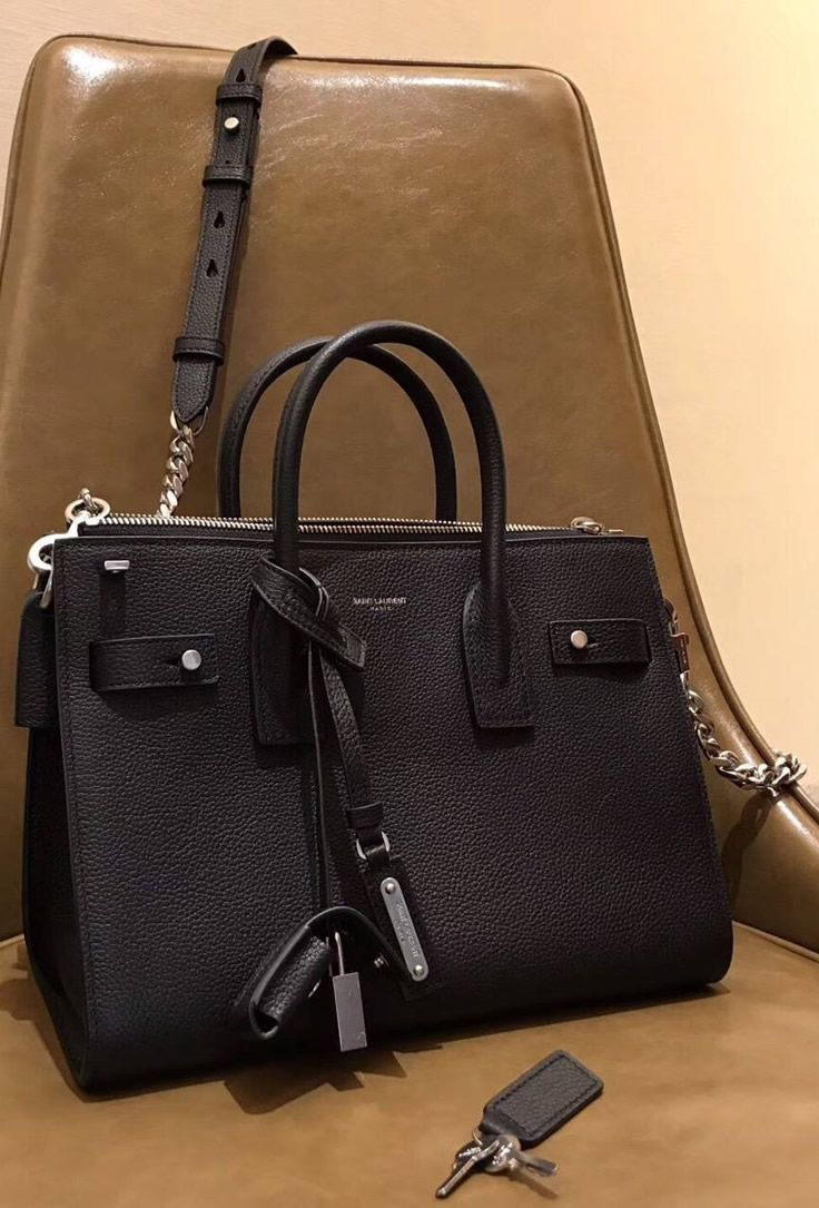 102c2aa80b35 Side gussets and compression tabs on the bag look great and they make this Saint  Laurent Baby Sac De Jour Souple Duffle Bag look even better or more ...