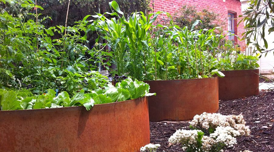 Prefabricated raised planters made from corten steel by