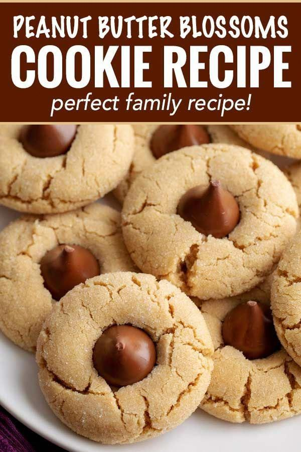 These classic and iconic Peanut Butter Blossoms Cookies are soft and chewy, with a crackly sugary crust and studded with a solid milk chocolate kiss.  Perfect for any holiday, bake sale or cookie exchange! #cookierecipe #cookie #Christmas #baking #peanutbutter #peanutbutterandchocolate #xmas #holidaybaking #holiday #WhichFoodIsHealthy