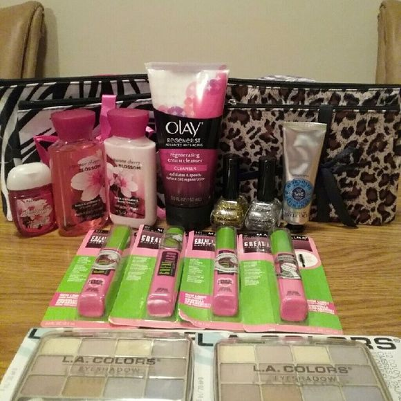 A Fabulous Assortment of Beauty Products Bath&Body Works  Japanese Cherry Blossom Vitamin E Shower Gel 3OZ , Body Lotion 3OZ and Hand Sanitizer 1OZ. 4 MaybellineGreat Lash Mascara. 2 L.A 12 Colors Eyeshadow. 1 Olay Regenerating Cleanser. 1 Silver Glitter Nail Polish, 1 Gold Glitter Nail Polish. 1 Loccitane Dry Skin Hand Cream 20% Shea Butter 2 Fashionable Makeup Bags Bath&Body Works  Makeup Mascara