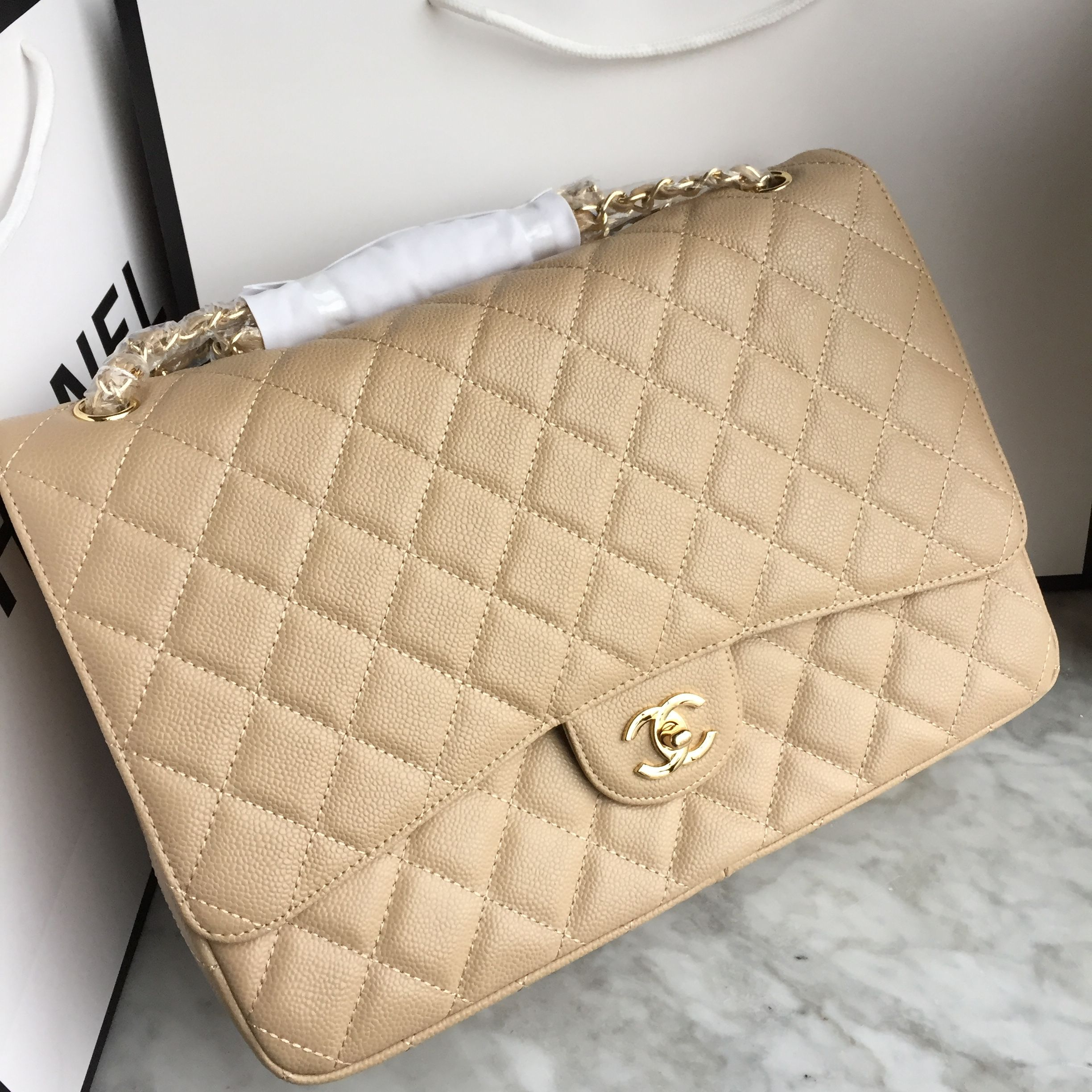48235de72ad6 Chanel woman chain flap bag 2.55 maxi caviar beige | Luxury in 2019 ...