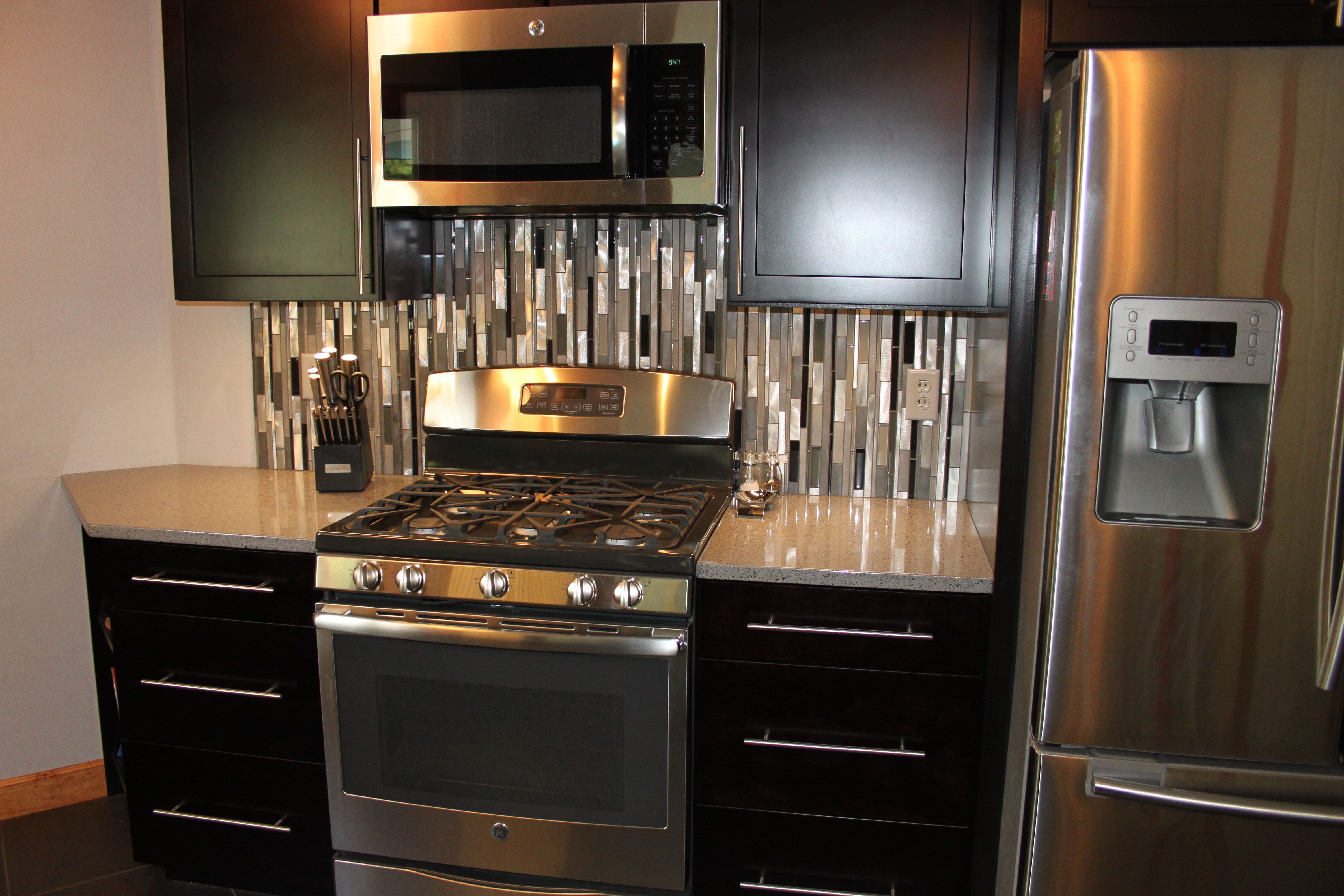 Waypoint Cabinetry Glazzio Glass Stainless Back Splash Silestone Countertops Blanco Sink Custom Kitchen Remodel Kitchen Remodel Design Silestone Countertops