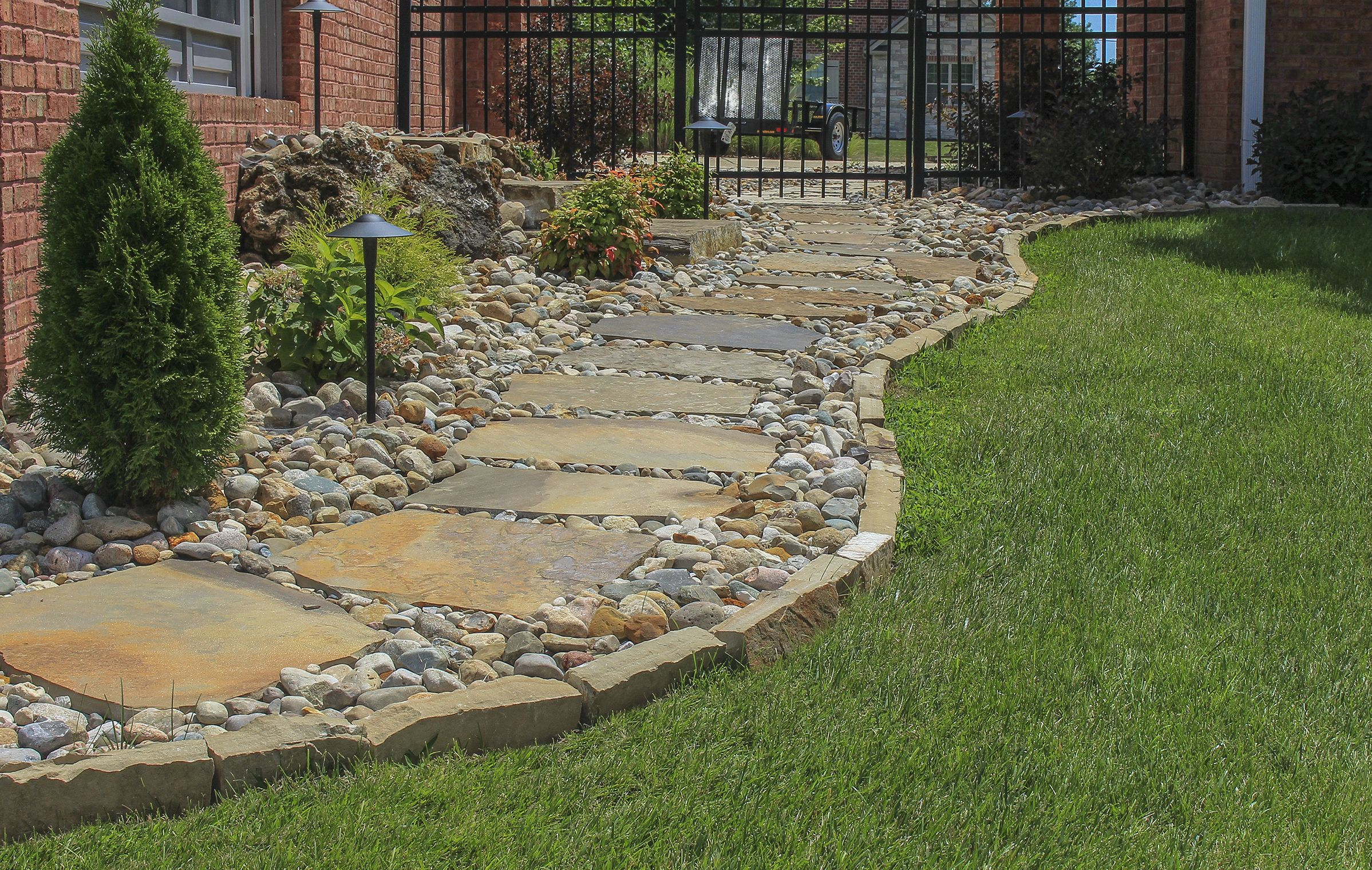 Gorgeous Natural Stone Walkway Accented With Natural Stone Edging And Gravel Love This Look Backyard Walkway Front Yard Landscaping Stone Walkway